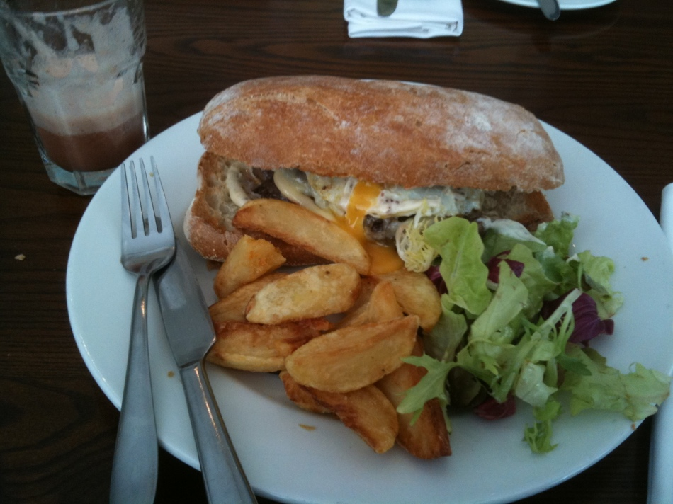 Empress steak and Cheddar cheese sandwich, fried egg, chips and salad