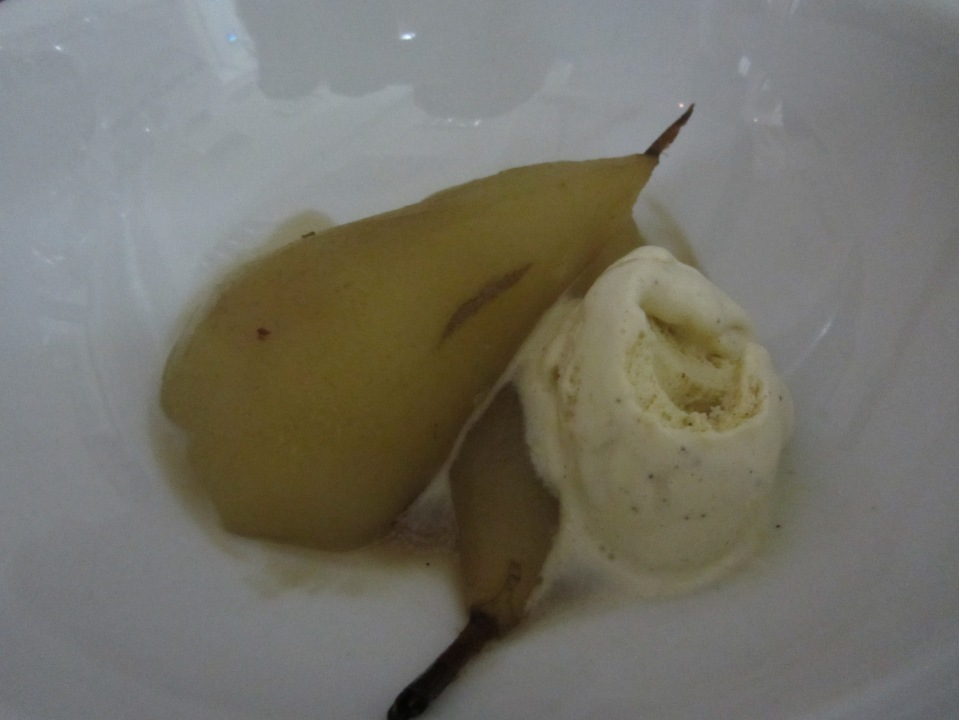 Poached pear with cinnamon syrup